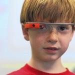 Google Glass. First-grader Peter Eiswert uses Google Glass to record pictures and video during el día de las naciones unidas en la St. James Academy